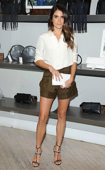 Nikki Reed, wearing her Nikki Reed X Freedom of Animals Sohalia Belt Bag, at the launch of her vegan bag line with Freedom Of Animals at Bloomingdale's Soho on October 10, 2015 in New York City.