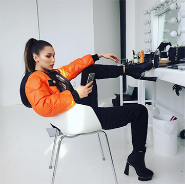Moschino Orange Quilted Jacket as seen on Bella Hadid Instagram