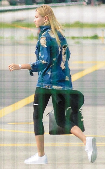 Nasty Gal Factory Holed Out Distressed Denim Jacket as seen on Hailey Baldwin