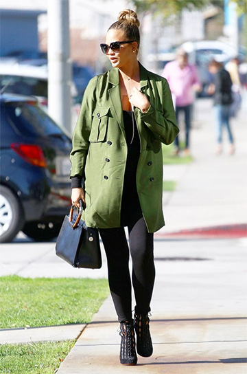 Alaia Laser Cut Lace Up Boots as seen on Chrissy Teigen