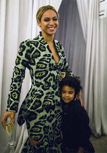 Beyonce poses with her daughter Blue Ivy in a green Givenchy Leopard Print Blazer and matching skirt.