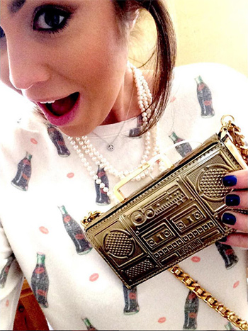 Kinsey Schofield wearing a Wildfox Loves Coca-Cola Spin The Bottle Jumper and Moschino Boombox Shoulder Bag in Gold.