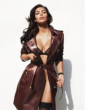 Kim Kardashian West wears a Burberry London Kensington Leather Trench Coat and Eres bra for GQ Magazine 2016.