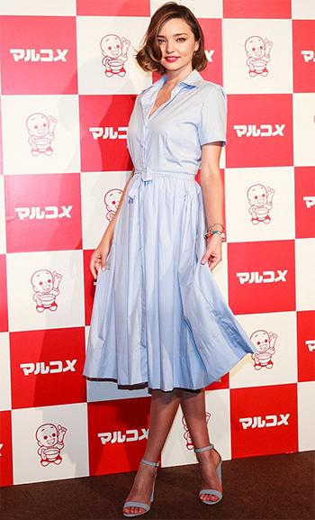 Miranda Kerr wears Schutz Enida Jean Blue Suede Sandals to a promotional event in Japan on June 20, 2016.