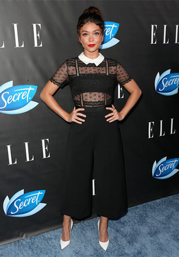 Sarah Hyland wears a Self-Portrait Floral Lace & Crepe Jumpsuit at ELLE's Women in Comedy Event on June 7, 2016 in West Hollywood, CA.