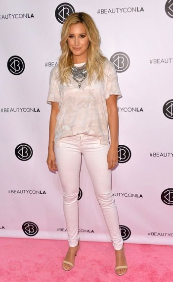 Ashley Tisdale wearing a Free People We The Free Ivory Army Tee and Givenchy sandals to the Beautycon Festival LA 2016 on July 9, 2016.