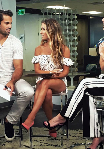 Jessie James Decker wearing Jen's Pirate Booty Bandana Darling Off-The-Shoulder Crop Top and matching Banjo Shorties on E! News, July 2016.