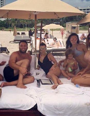 Kourtney Kardashian on Instagram wearing Le Specs Prince Sunglasses and a La Perla Mirage laser-cut swimsuit on the beach in Miami, FL - July 2016.