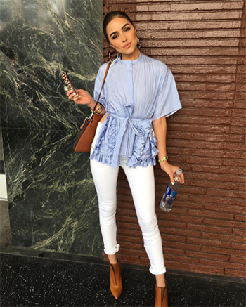 Olivia Culpo wears a Ports 1961 Tassel Trim Shortsleeved Shirt, Chloe croc bag and Unravel Lace Up Leather Pants.