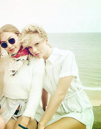 Taylor Swift wears a L'Academie The Shirt Dress in Blue Stripe on friend Abigail Lauren Anderson's Instagram page (alongside Gigi Hadid) on July 4, 2016.
